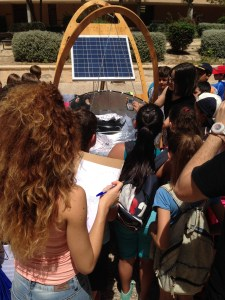 And the kids checking out solar powered cooking