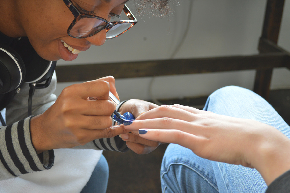 manicurist painting nails