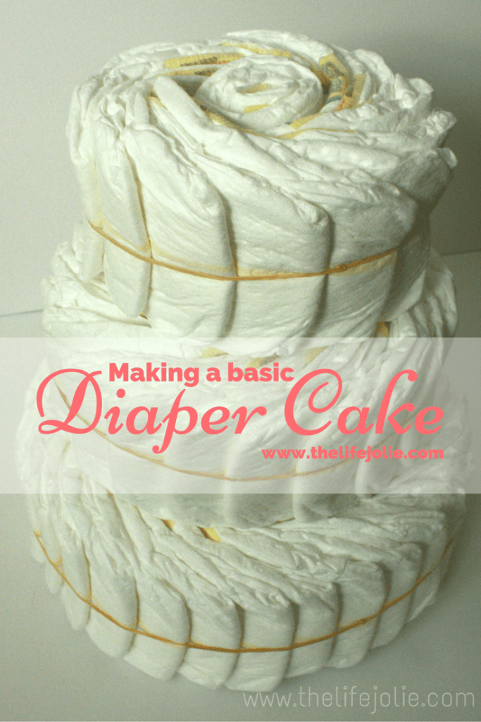 How to make a basic diaper cake- this is a tutorial for making the cake before you decorate it- it's super easy and will wow all of the other party guests!