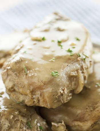 Say goodbye to overcooked pork chops! These Slow Cooker Pork Chops are the perfect weeknight and back-to-school meal! Only 3 ingredients and with minimal work, this recipe leaves you with pork chops that are fall-apart tender and savory and delicious juices that make a fantastically savory gravy!