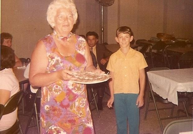 Me standing behind my mom
