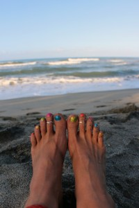 Nothing happier than skittle-colored toes on the beach.