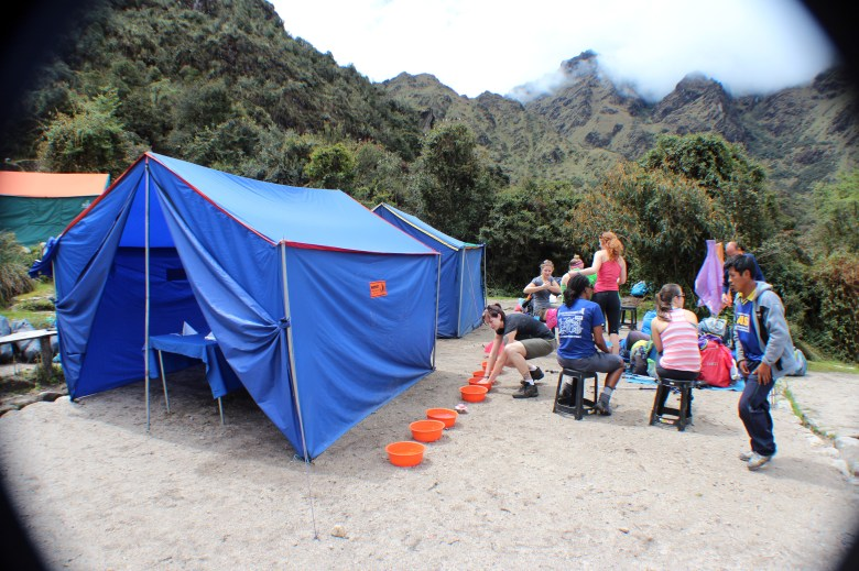 """One of my fellow travelers referred to this as """"Glamping"""" as we had a dining room tent, and you can see the orange containers full of hot water for washing up before lunch. Fantastic."""