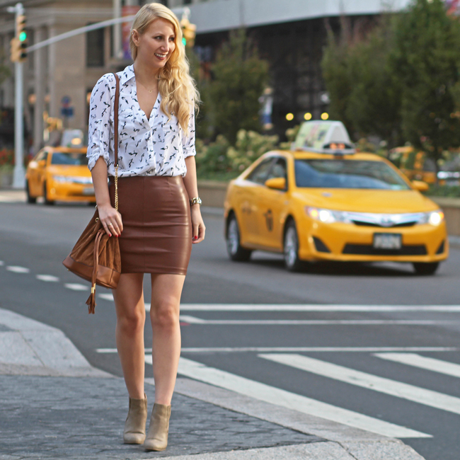Fall outfit: brown faux leather mini skirt with Express portofino shirt, taupe ankle boots, and brown bucket bag