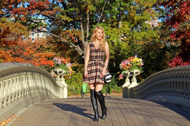 Wearing a plaid dress, striped bag, and over-the-knee boots on Bow Bridge