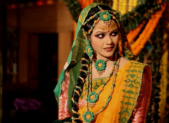 A bride ready for Gaye holud ( yellow turmeric on the body ) A ceremony observed in Bangladesh during marriages - Image by hasiB wahaB