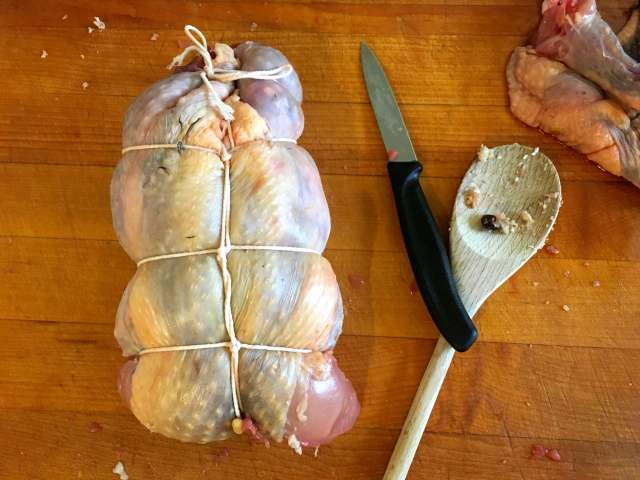 A ballotine of guinea fowl, stuffed with bacon and nuts
