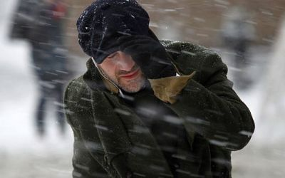 A commuter makes his way through heavy snow in New York