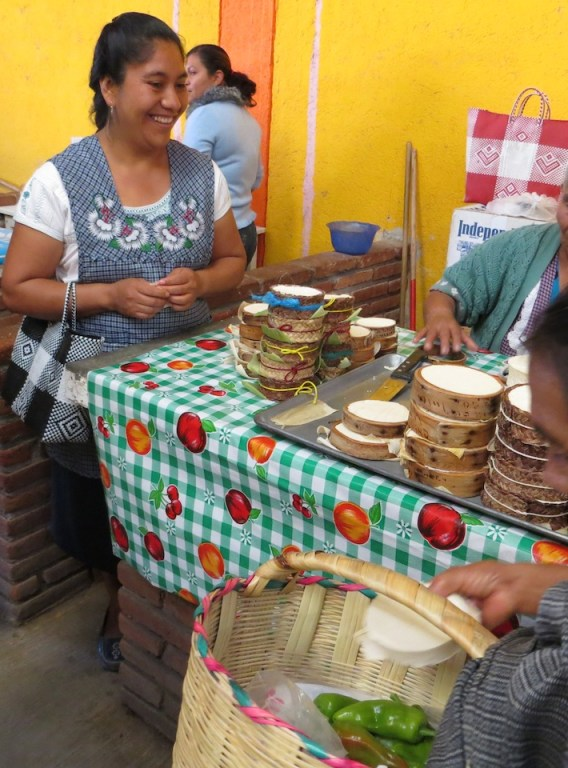 Reyna Mendoza at the market in Teotitlán del Valle, Oaxaca. Photo by Dolores Wiarco Dweck.
