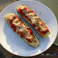 These Sweet Italian Sausage Stuffed Zucchini Boats are made with garden-fresh zucchini stuffed with mozzarella cheese and sweet Italian sausage mixed with diced tomatoes and herbs, piled high with even more cheese! | TheMountainKitchen.com