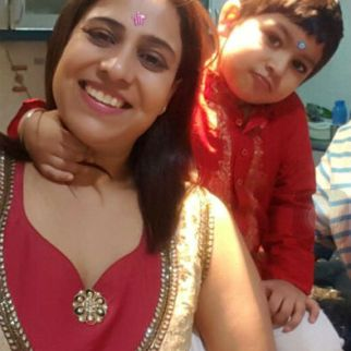 """Motherhood to me means doing just anything to make my son smile, laugh and have a great time together always. Even if that means letting him put a start sticker on the forehead and pose, as you see in this picture."" -Shikha"