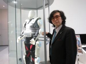 "<img src=""http://i2.wp.com/www.thenextrex.com/wp-content/uploads/2015/04/sankai-e1429000648124.jpg?resize=300%2C225"" alt=""Cyberdyne's CEO - Mr. Yoshiuki Sankai>"