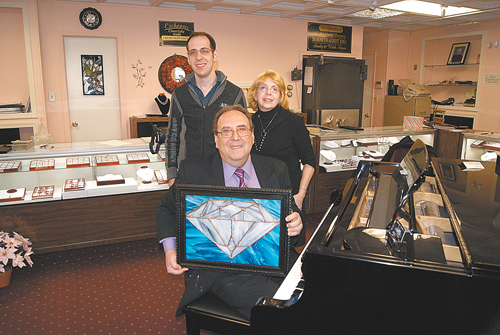 Photo by Karen ZautykRichard Donato with son, Rick, and wife, Joan. (Rick, in addition to being a jeweler, also works in stained glass, one example of his craft proudly displayed by his dad.)