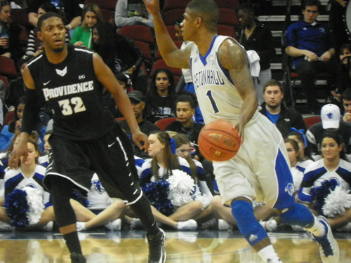 Photo by Jim HagueSeton Hall point guard Aaron Cosby (right, wearing No. 1) tries to make a move past Providence's Vincent Council (32) in Providence's 67-55 win over the Pirates Sunday at the Prudential Center.