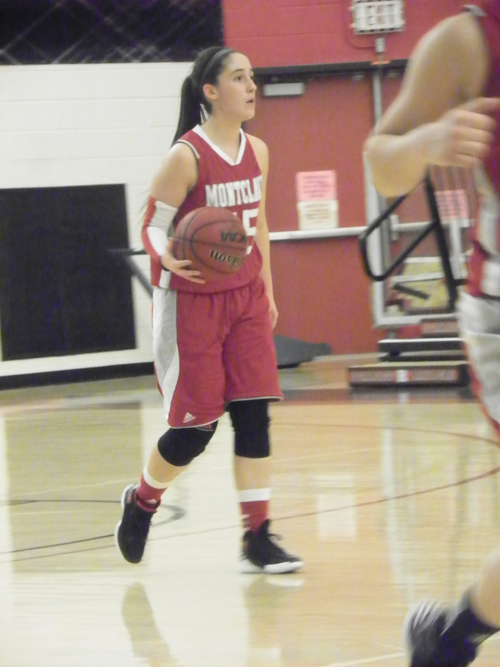 Photo by Jim HagueKearny's Janitza Aquino is having a fi ne year as the starting point guard at Montclair State.