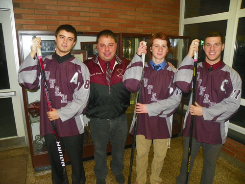 Photo by Jim HagueThe Nutley hockey team has been rolling along, posting a 16-1-3 record and earning entrance into the state's Top 20. From left are Will Paro, head coach Eric Puzio, Anthony Gandolfi and David Fierro.