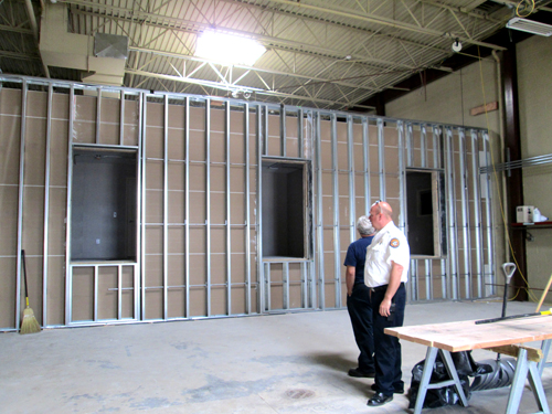 Photo by Ron Leir Kearny Fire Chief Steven Dyl checks work on Police/Fire Station.