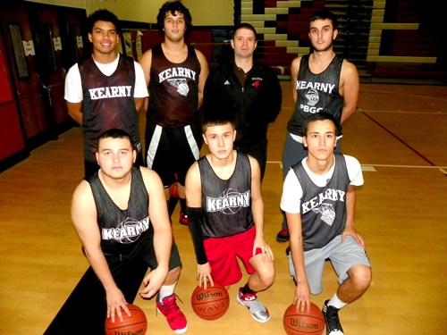 Photo by Jim Hague Last December, Bill Schoener (back row, center) seemed poised and ready to begin a long term assignment as the Kearny boys' basketball coach. Schoener recently suddenly resigned after one season, leaving Kearny to search once again for a new head coach.