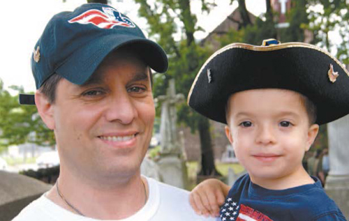 Photo by Karen Zautyk Pint-sized patriot Samuel Lacroix, 2, of Belleville, with his dad, Mark