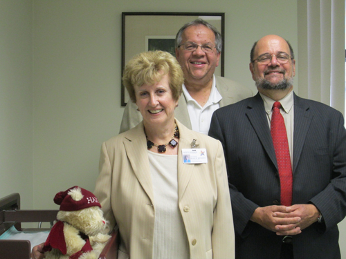 Photo by Ron Leir NHCAC leader Joan Quigley, Mayor Ray McDonough (c.) and NHCAC Director of Operations Vincent Yurgola inside the future Harrison Health Center.