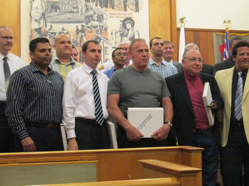 Photo by Ron Leir Members of Nutley Auxiliary Police receive congratulations and plaques from Mayor Alphonse Petracco (r.) and fellow commissioners.