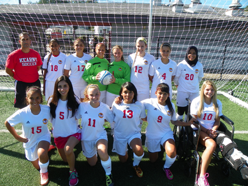 Photo by Jim Hague The Kearny girls' soccer team will have almost a totally rebuilt defense this season. Front row from l. are Gisselle Blancas, Chelsea DaSilva, Lacey Burton, Ashley Castaneda, Alexis Castaneda and Amanda Eustice. Back row, from l., are Isabel Fernandez, Ryelle Seda, Amanda DeSousa, Laura Vilar, Dana Green, Eliza Rodrigues and Salma Bouzidi.