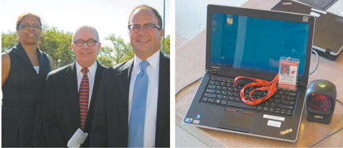 "Photos by Ron Leir LEFT: At KHS convocation, from l., are Assistant Superintendent Debra Sheard, consultant Charles Ivory and Superintendent of Schools Frank Ferraro. RIGHT: Laptop ""registers"" KHS students via scanner and ID card."