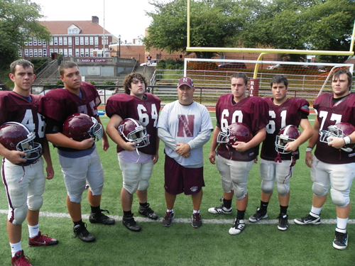 Photo by Jim Hague The Nutley football team will look to improve with the work of their front line. From l. are Gabriel Tortora, Randy Rauco, Jesse Defuria, head coach Tom Basile, Brian Devine, Mike Buckley and Chris Palma