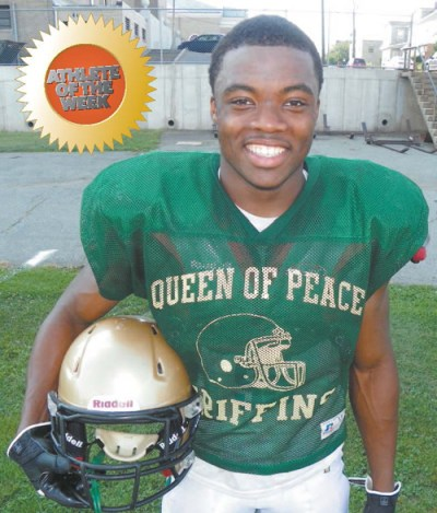Photo by Jim Hague Queen of Peace senior running back/linebacker Kevin Momnohin.
