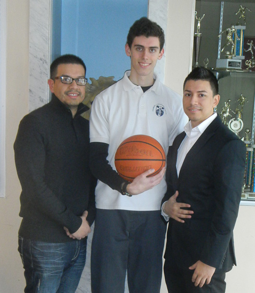 Picture courtesy of David J. Friere Kearny Christian Academy senior John Bianoski (c.) owned the highest scoring average in local boys' high school basketball, scoring 25 points per game this season. Flanking Bianoski are coaching brothers Ariel Friere (l.), the head coach, and assistant coach David J. Friere.