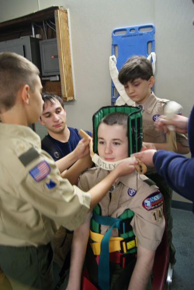 Photos by Karen Zautyk Scouts from Troop 142 get hands-on lessons in first aid for accident victims.