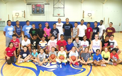 Photo by Jim Hague The Harrison basketball camp for boys and girls was held last week at the Washington Middle School under the leadership of head coach Noel Colon (back row, right of center) and guest speaker Gian Paul Gonzalez (back row, left of center).