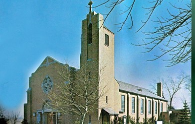 Our Lady of Sorrows Church on Davis Ave. celebrates its centennial Sunday. If this photo looks a bit different from the site's current appearance, that's because it shows the church in the early 1950s, when the now-lush trees were only saplings.