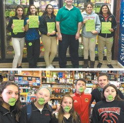Photos courtesy Karena Malko KHS students and merchants make a point about preventing underage drinking as part of 'Sticker Shock' Campaign. Top photo shows Rob Renz of Spirits of Kearny with students. In bottom photo, REACH advisor/teacher Robert Kelly is with students at Tony's Deli.