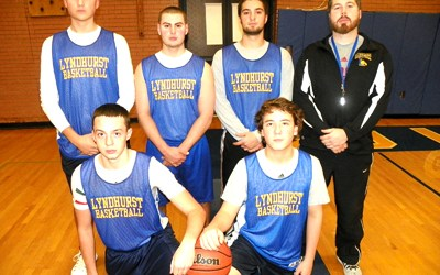 Photo by Jim Hague The Lyndhurst High School boys' basketball team has a new head coach in a familiar face, namely former Queen of Peace head coach Tom McGuire (standing, far r.). Kneeling, from l., are Eddie Albuquerque and Nic DiTommaso. Back row from l. are Justin Smith, Vinnie Dorio, Peter Lazaris and McGuire.