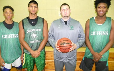 Photo by Jim Hague The Queen of Peace basketball program welcomes back alum Christian Boyce after a four-year absence as head coach. From left are Josh Pierre-Louis, Jeremy Joseph, Boyce and Ibn Christmas.