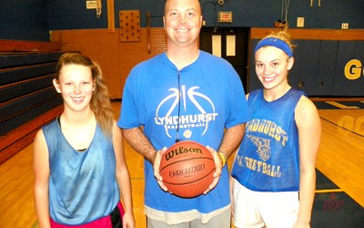 Photo by Jim Hague The Lyndhurst High School girls' basketball team will look to seniors Joanne Arvanitakis (l.) and Cameron Halpern (r.), with head coach John Cousins (c.) to lead the way this season.