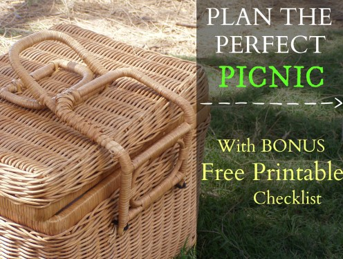 Wicker picnic basket on grass in the park