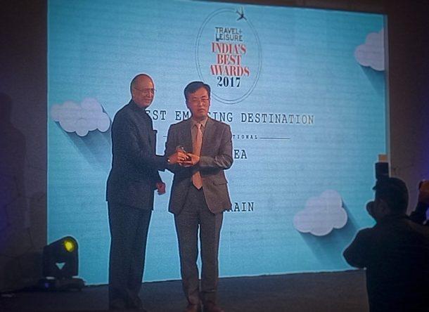 Mr. Dipak Haksar presenting Award to South Korea Tourism Board Official