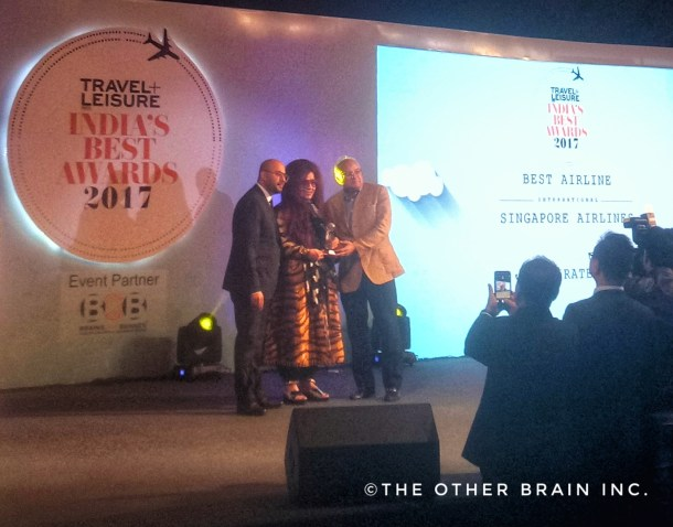 Entrepreneur and Beauty Expert Shahnaz Husain presenting award to Singapore Airlines Officials