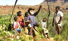 Aboriginal traditional owner and elder of Nyikina country, John Watson, shows his grandchildren his special lands in Western Australia's Kimberley area. © Photo, Lyndon Mechielsen