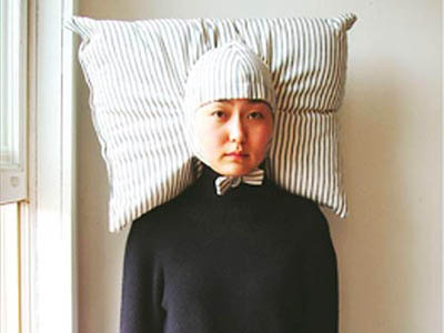 we all need this nap-pillow-wig-hat in our lives.