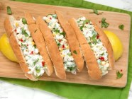 Give a refreshing twist to traditional lobster roll - Try these Summer Lobster Rolls filled up with vibrant and light ingredients for the perfect summertime treat! Recipe by thepetitecook.com