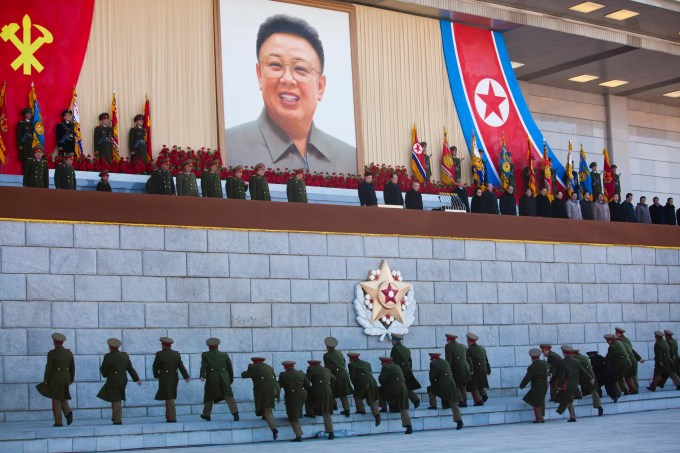 Senior North Korean military members approach an area where new North Korean leader Kim Jong Un and other military and political leaders stand at Kumsusan Memorial Palace in Pyongyang before reviewing a parade of thousands of soldiers and commemorating the 70th birthday of the late Kim Jong Il on Thursday, Feb. 16, 2012.