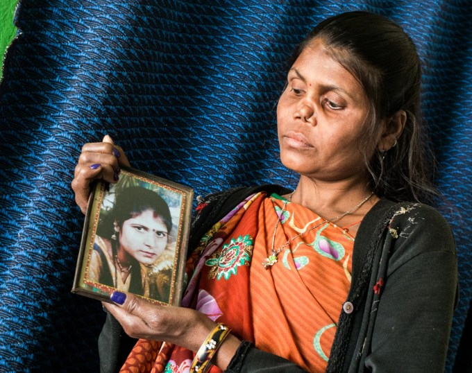 Radha, age 30, with a portrait of herself before leprosy caused her nasal cartilage to collapse