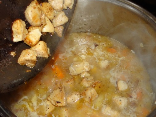 Add chicken to rice when rice is nearly done cooking.