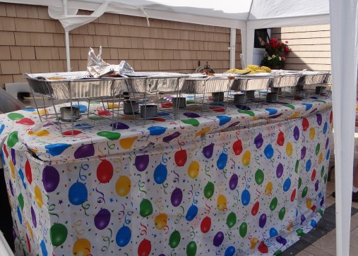 Food was all set up atop a balloon printed table covering.