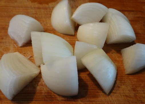 Start off by preparing your vegetables. I am chopping these onions pretty large, about the size of a half dollar... so you will either need one large onion as I have here or two medium.