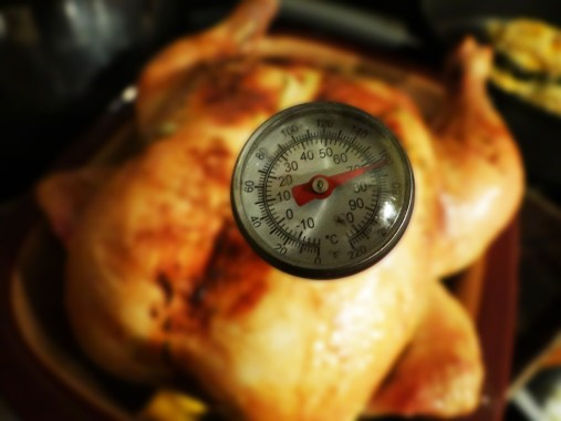 Baste chicken throughout the cooking process.  When the temperature in the deepest part of the breast comes to between 160°F - 165°F, you are ready to take the chicken out of the oven and cover immediately with foil for 15 minutes or so.