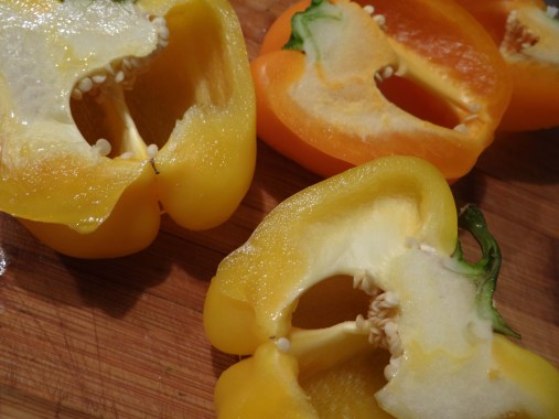 Cut each pepper in half lengthwise. This will later lead to a more crispy top on your stuffing.
